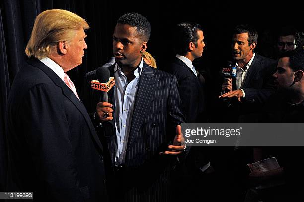 Chairman and CEO of the Trump Organization media personality Donald Trump and Donald Trump Jr speak with entertainment reporters AJ Callaway and AJ...