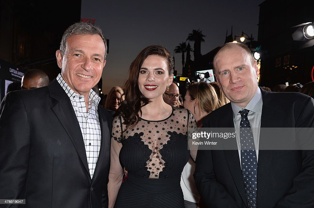 Chairman and CEO of The Walt Disney Company Bob Iger, actress Hayley Atwell and President of Production at Marvel Studios Kevin Feige attend the premiere of Marvel's 'Captain America: The Winter Soldier' at the El Capitan Theatre on March 13, 2014 in Hollywood, California.