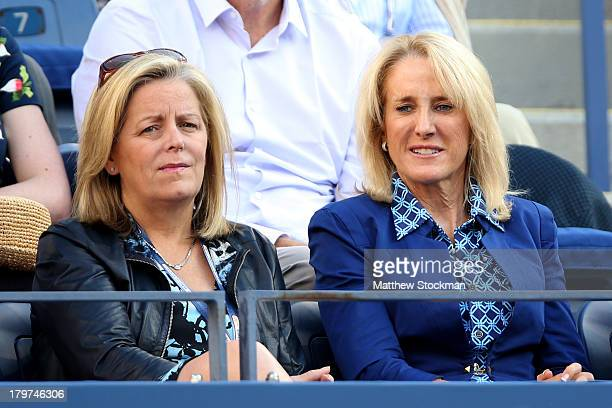 Chairman and CEO of the Women's Tennis Association Stacey Allaster and Tracey Austin watch the women's singles semifinal match between Serena...