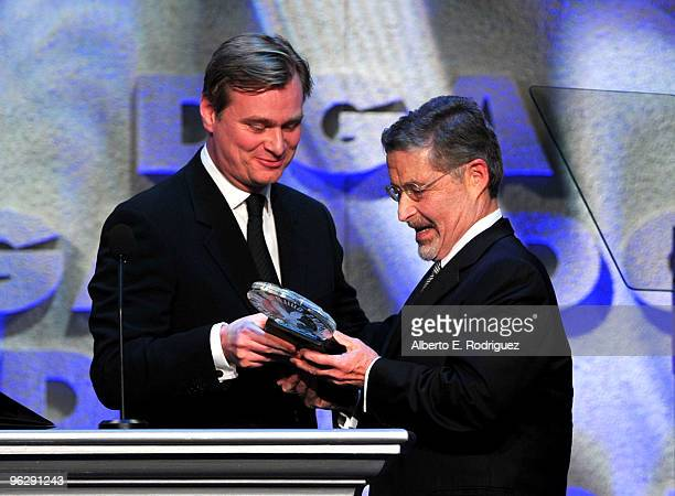 Chairman and CEO of Warner Bros Entertainment Inc Barry Meyer accepts the DGA Honorary Life Membership onstage from filmmaker Christopher Nolan...