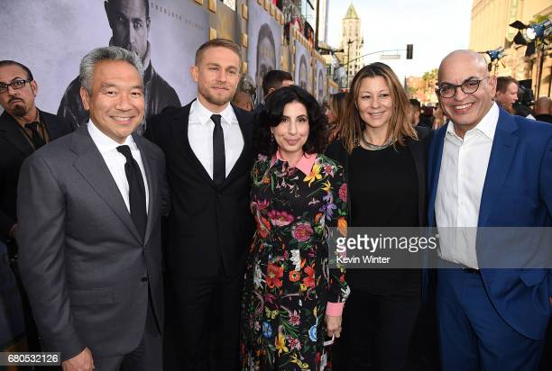 Chairman and CEO of Warner Bros Entertainment Kevin Tsujihara actor Charlie Hunnam President Worldwide Marketing and Distribution for Warner Bros...