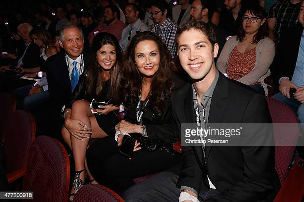Chairman and CEO of ZeniMax Media Robert A Altman and actress/wife Lynda Carter pose for a photograph with their children Jessica and James as they...