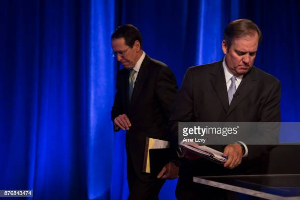 Chairman and CEO Randall Stephenson and ATT Senior Executive Vice President David R McAtee II leave after a news conference in Time Warner...