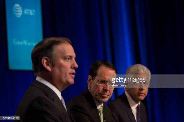 Chairman and CEO Randall Stephenson and retained Counsel from O'melveny Myers listen to ATT Senior Executive Vice President David R McAtee II at a...