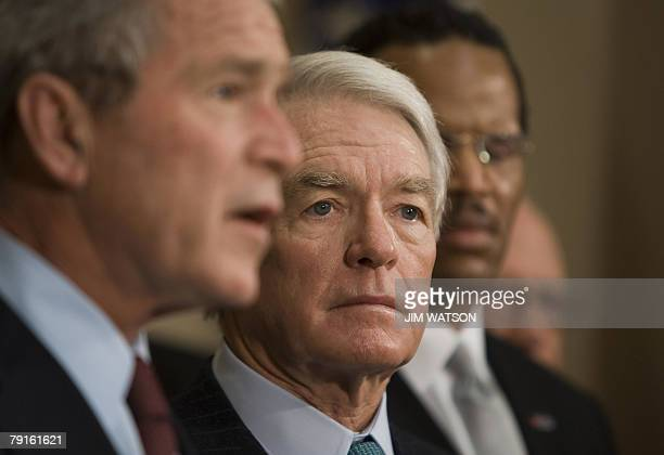 Chairman and Chief Executive Charles Schwab listens as US President George W Bush announces the Presidents Advisory Council on Financial Literacy at...