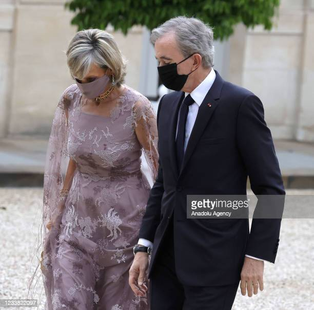 Chairman and Chief Executive of LVMH Bernard Arnault and his wife Hélène Mercier-Arnault arrive for a state dinner with the French President...