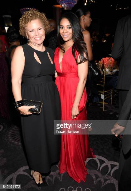 Chairman and Chief Executive Officer of BET Debra Lee and host Regina Hall attend BET Presents the American Black Film Festival Honors on February 17...