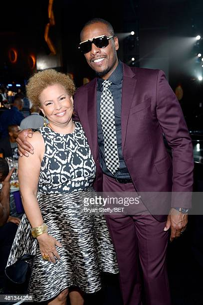 Chairman and Chief Executive Officer of BET Debra Lee and Paul Pierce of the Los Angeles Clippers appear backstage at The Players' Awards presented...