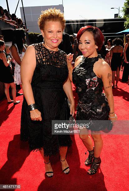 Chairman and Chief Executive Officer of BET Networks Debra L Lee and Tameka 'Tiny' Harris attend the BET AWARDS '14 at Nokia Theatre LA LIVE on June...