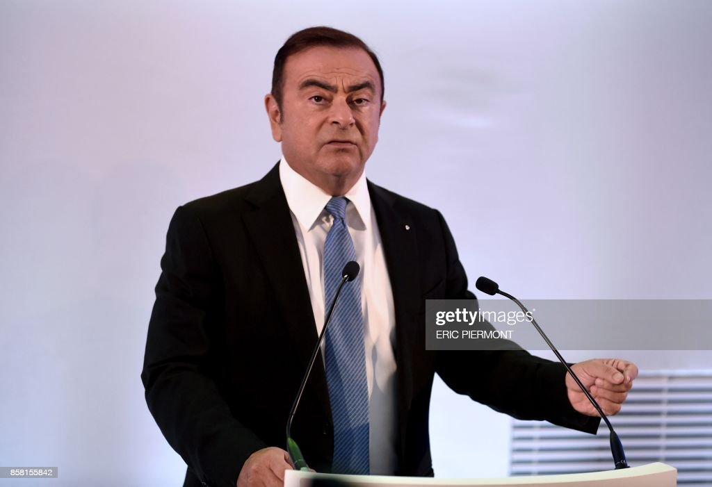 Chairman and Chief Executive Officer (CEO) of French carmaker Renault, Carlos Ghosn addresses a press conference to present the automobile company's 5-year strategic plan 'Drive the Future 2017-2022' in La Defense, near Paris, on October 6, 2017. Renault plans to sell five million vehicles until 2022, as part of its new strategic plan, which means an increase of 44 percent compared to 2016, the French automobile group said on October 6. /