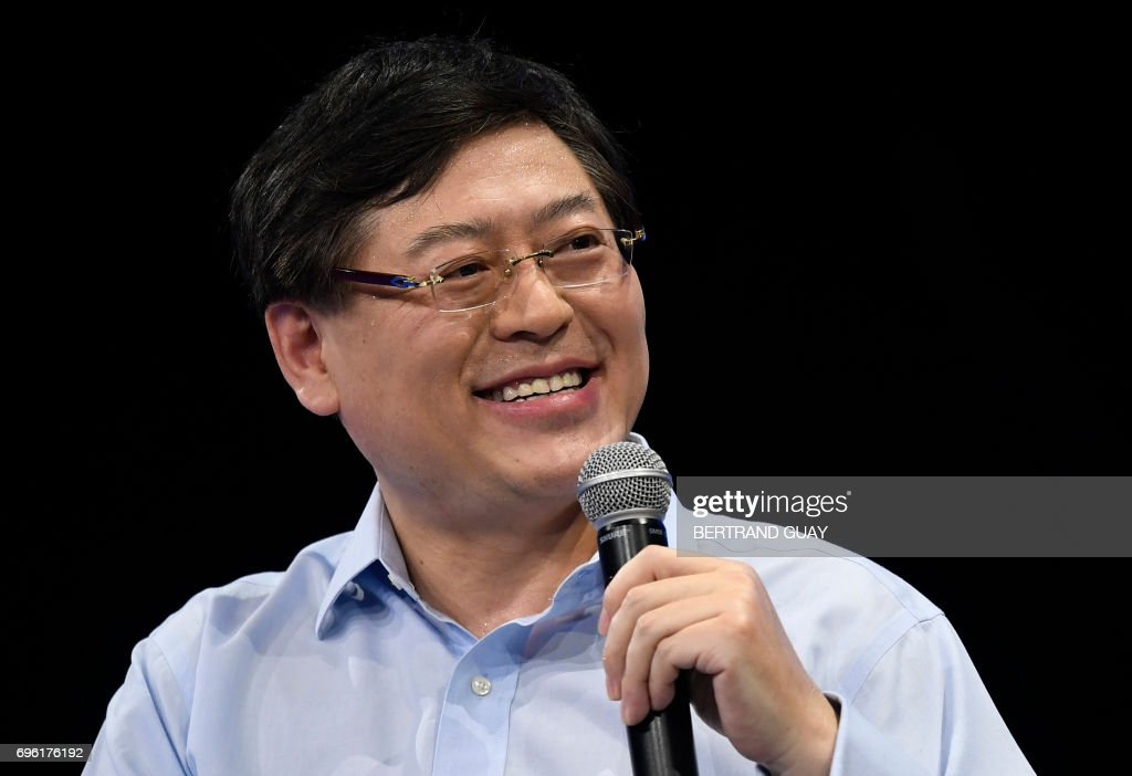 Chairman and Chief Executive Officer (CEO) of Lenovo Group Yuanqing Yang speaks during a session at The Viva Technology Event in Paris on June 15, 2017. /