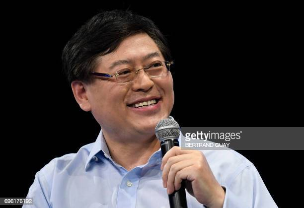 Chairman and Chief Executive Officer of Lenovo Group Yuanqing Yang speaks during a session at The Viva Technology Event in Paris on June 15 2017 /...