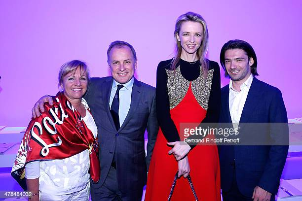 Chairman and Chief Executive Officer of Louis Vuitton Michael Burke with his wife Brigitte Louis Vuitton's executive vice president Delphine Arnault...