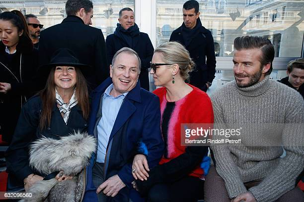 Chairman and Chief Executive Officer of Louis Vuitton Michael Burke Kate Moss and David Beckham attend the Louis Vuitton Menswear Fall/Winter...