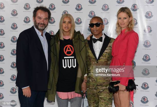 Chairman and Creative Director of Moncler Remo Ruffini Helen Lasichanh Pharrell Williams and Karolina Kurkova attend a private dinner celebrating...