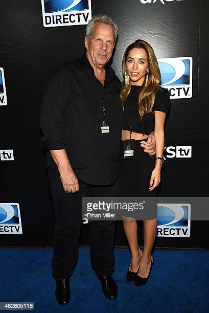 Chairman and Executive Vice President of the New York Giants Steve Tisch and Katia Francesconi attend DirecTV Super Saturday Night hosted by Mark...