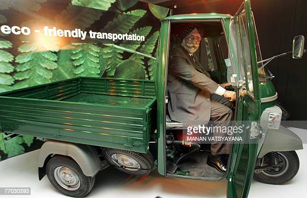 Chairman and Managing Director OF Piaggio Vehicles Ravi Chopra poses with the newly launched Piaggio Ape' CNG 3wheeled vehicle in New Delhi 26...