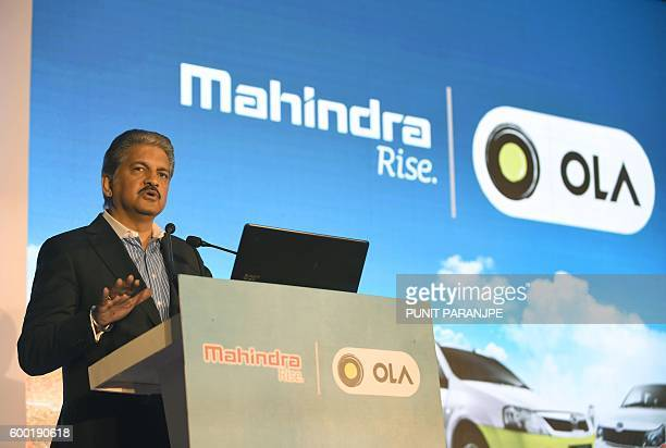 Chairman and Managing Director of the Mahindra and Mahindra Group Anand Mahindra speaks during a joint news conference with CEO of Ola cabs Bhavish...