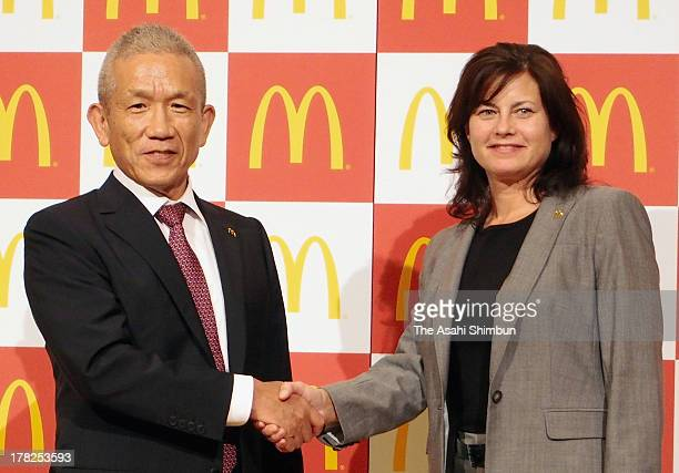 Chairman and president of McDonaldfs Holdings Co Eikoh Harada shakes hands with new McDonald's Japan CEO Sarah Casanova August 27 in Japan Sarah...