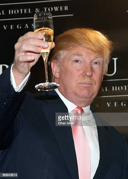 Chairman and President of the Trump Organization Donald Trump leads a champagne toast during an opening ceremony for the Trump International Hotel...