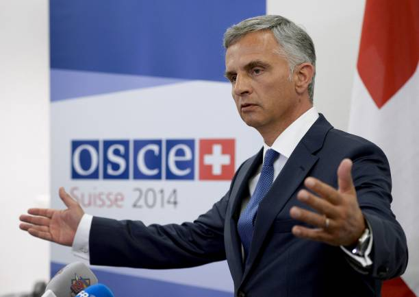 osce chairman and swiss president didier burkhalter gestures during