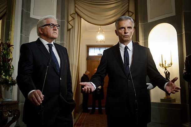 osce chairman and swiss president didier burkhalter r gestures