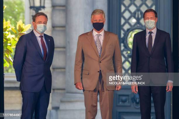 Chairman Bart De Wever, King Philippe - Filip of Belgium and PS chairman Paul Magnette pictured after a meeting with the King at the Royal Palace in...