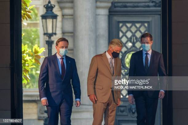 Chairman Bart De Wever, King Philippe of Belgium and PS chairman Paul Magnette walk after a meeting with the King at the Royal Palace in Brussels, on...
