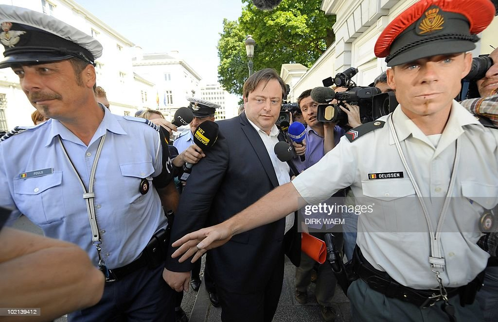 N-VA chairman Bart De Wever (C), winner of the federal elections of June 13, 2010 leaves after attending a meeting with outgoing Prime Minister Yves Leterme, on June 16, 2010 as they discussed over Belgium's presidency of the European Union, which starts on July 1, 2010 for a duration of six months.