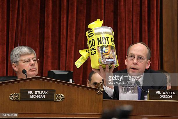 Chairman Bart Stupak watches as Rep Greg Walden holds up a jar of candy peanut products while questioning Stewart Parnell owner and president of the...