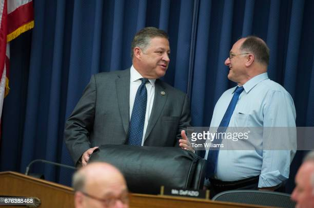 Chairman Bill Shuster RPa left and Rep Michael Capuano DMass talk before a House Transportation and Infrastructure Committee hearing in Rayburn...