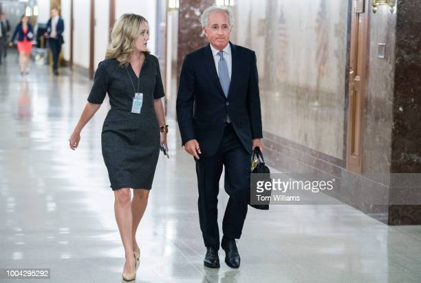 Chairman Bob Corker RTenn and aide Micah Johnson arrive for a Senate Foreign Relations Committee hearing in Dirksen Building on the nominations of...
