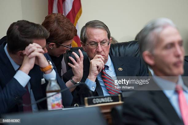 Chairman Bob Goodlatte RVa talks with aides during a House Judiciary Committee hearing in Rayburn Building featuring testimony by Attorney General...
