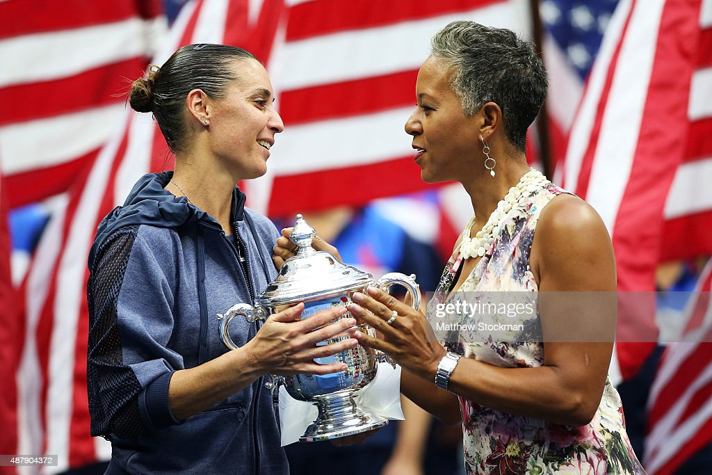 Chairman, CEO and president Katrina Adams (R) presents the winner's trophy to Flavia Pennetta of Italy after she defeated Roberta Vinci of Italy during their Women's Singles Final match on Day Thirteen of the 2015 US Open at the USTA Billie Jean King National Tennis Center on September 12, 2015 in the Flushing neighborhood of the Queens borough of New York City. Pennetta defeated Vinci 7-6, 6-2.