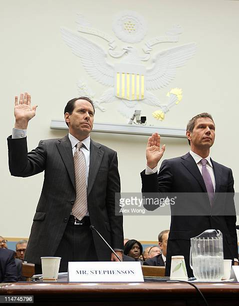 Chairman CEO and president of ATT Randall Stephenson and CEO of Deutsche Telekom AG Rene Obermann are sworn in during a hearing before the...