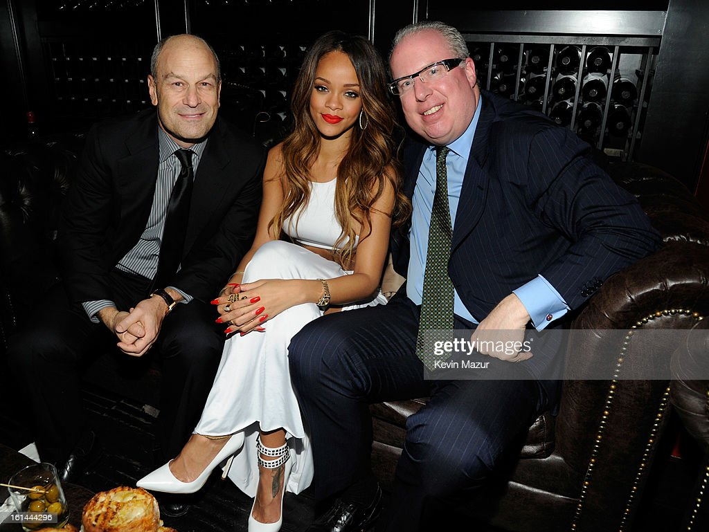Chairman & CEO of Island Def Jam and Universal Motown Republic Group Barry Weiss, Rihanna and President/COO of Island Def Jam Music Group, Steve Bartels attend the Island Def Jam Grammy Party Sponsored By Samsung And Pepsi at Osteria Mozza on February 10, 2013 in Los Angeles, California.