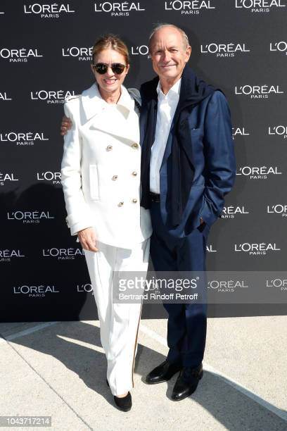 Chairman Chief Executive Officer of L'Oreal and Chairman of the L'Oreal Foundation JeanPaul Agon and his wife Sophie attend Le Defile L'Oreal Paris...