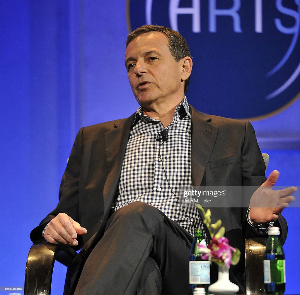 Chairman & Chief Executive Officer of the Walt Disney Company Robert A. Iger is interviewed by Academy Award Winning Producer and Co-Chairman of Imagine Entertainment Brian Grazer at the Hollywood Radio & Television Society Newsmaker Luncheon Series at The Beverly Hilton Hotel on January 23, 2013 in Beverly Hills, California.