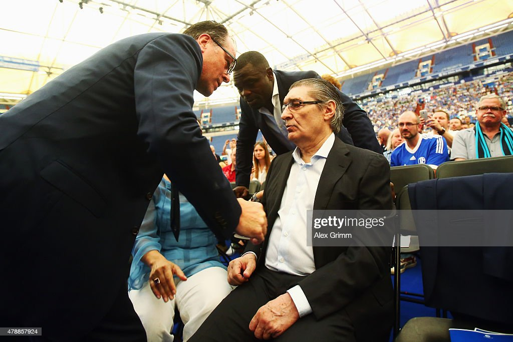 Chairman Clemens Toennies and Gerald Asamoah, a former player, welcome the club's former manager Rudi Assauer during the general assembly of FC Schalke 04 at Veltins-Arena on June 28, 2015 in Gelsenkirchen, Germany.