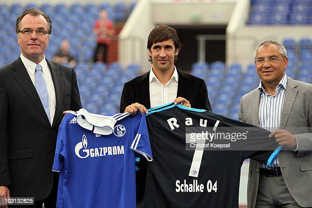 Chairman Clemens Toennies Raul Gonzalez and head coach Felix Magath of Schalke present the new jersey during the FC Schalke press conference at the...