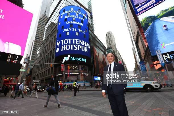 Chairman Daniel Levy poses as a Tottenham Hotspur advert plays on a screen in Time Square on July 25 2017 in New York New York