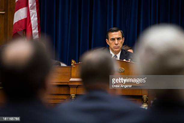 Chairman Darrell Issa listen to testimony from witnesses during a House Oversight Committee hearing entitled 'Reviews of the Benghazi Attack and...