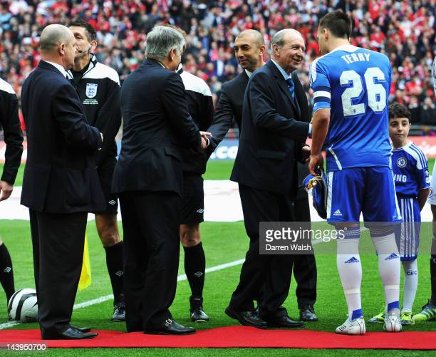 Chairman David Bernstein shakes hands with Roberto Di Matteo caretaker manager of Chelsea and chief guest Jimmy Armfield shakes hands with John Terry...
