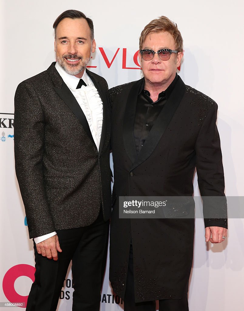 Chairman David Furnish (L) and Founder Sir Elton John attend the Elton John AIDS Foundation's 13th Annual An Enduring Vision Benefit at Cipriani Wall Street on October 28, 2014 in New York City.