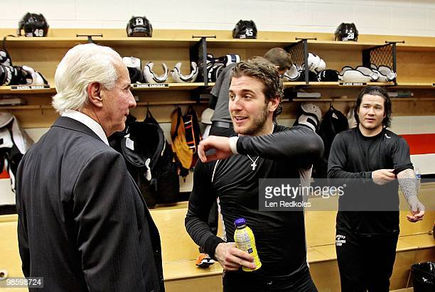 Chairman Ed Snider greats Mike Richards and Arron Asham of the Philadelphia Flyers in the locker room after defeating the New Jersey Devils 41 in...