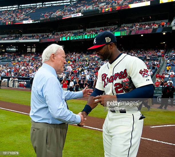 Chairman Emeritus of the Atlanta Braves Bill Bartholomay shakes hands with Jason Heyward of the Atlanta Braves after throwing out the ceremonial...