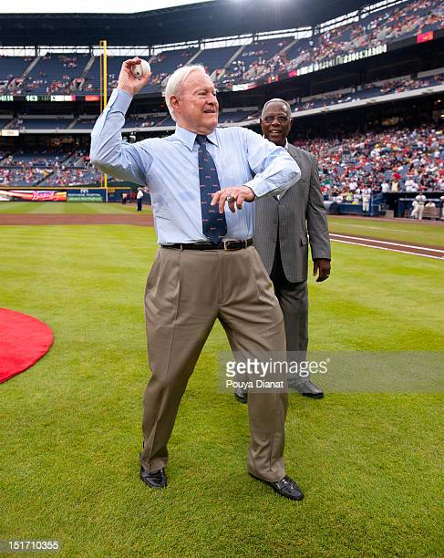 Chairman Emeritus of the Atlanta Braves Bill Bartholomay throws out the ceremonial first pitch as Hall of Famer Hank Aaron looks on before the Delta...