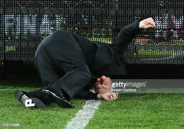 FFA chairman Frank Lowy falls off the stage as he presents Victory with the winners trophy the 2015 ALeague Grand Final match between the Melbourne...
