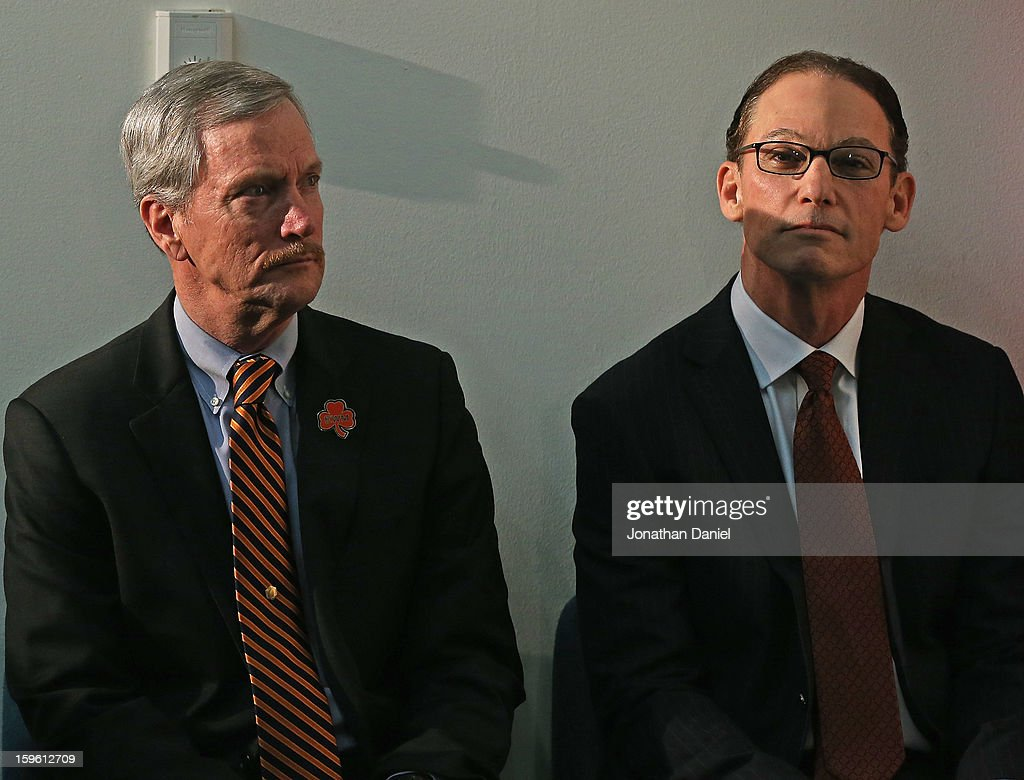 Chairman George McCaskey of the Chicago Bears (L) sits with new head coach Marc Trestman during an introductory press conference at Halas Hall on January 17, 2013 in Lake Forest, Illinois.