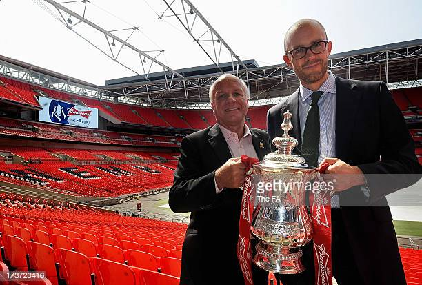 Chairman Greg Dyke and Managing Director of BT Retail's consumer division John Petter pose for the camera with the FA Cup as the BBC and BT Sport...